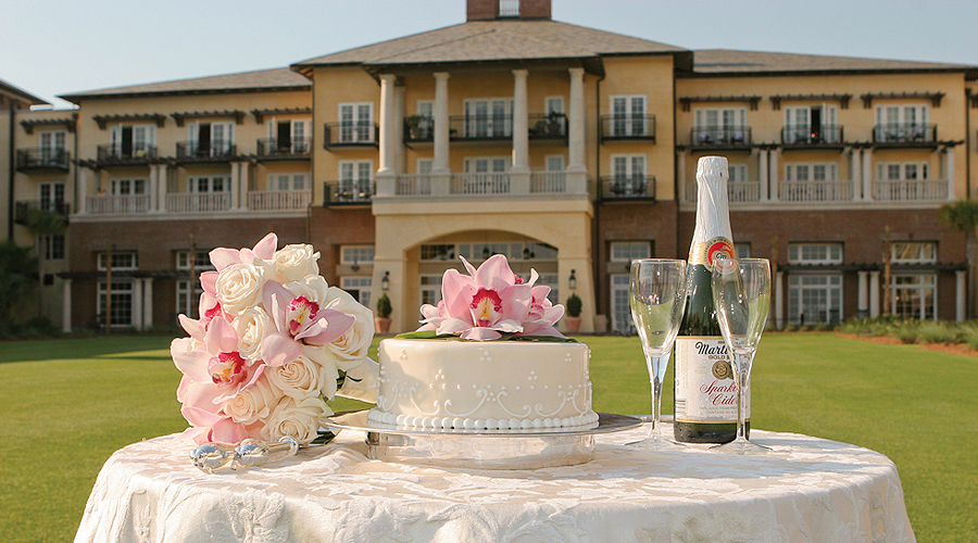 Wedding cake champagne set up for wedding on grand lawn